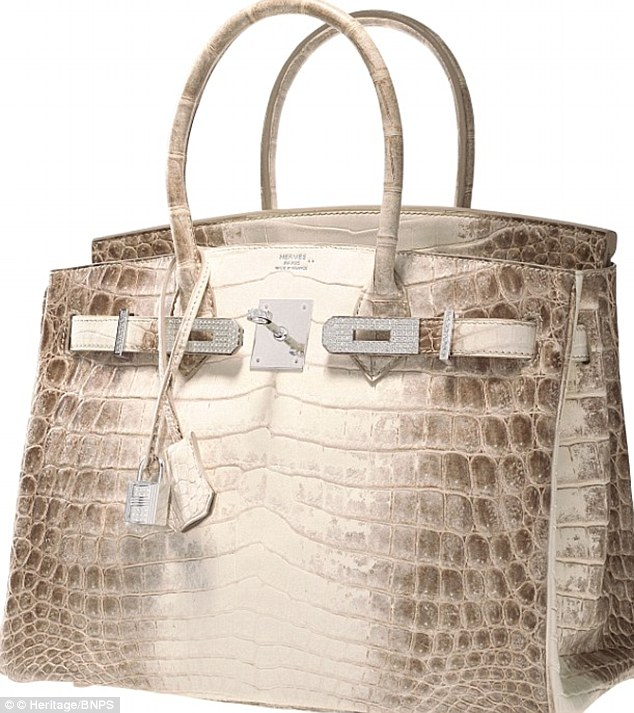ae729fb17aa The  extraordinarily rare  bag is encrusted with 245 diamonds and boasts an  18-