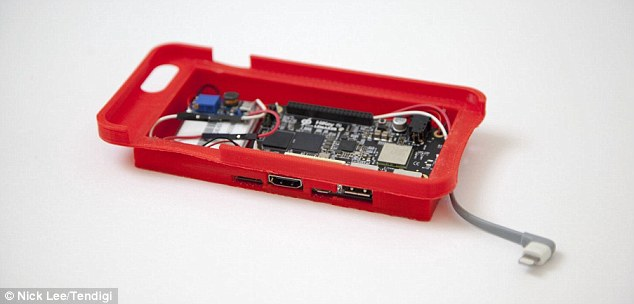 The final product, pictured, is a red case with an extended back that is ¿not too much thicker than the average battery case,¿ and openings for an SD card, HDMI, and USB ports