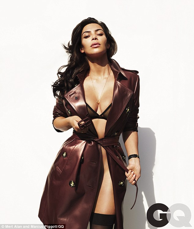 Underwear optional: Kim also posed in a bra, pull-up stockings and no knickers with an overcoat