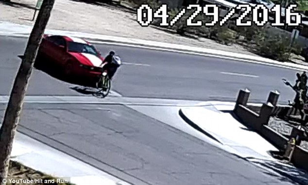 This is the moment the red Ford Mustang plowed into the man who was riding on his bike on the morning of April 29