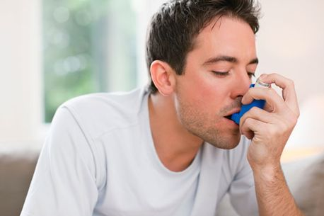 man-using-asthma-inhaler-pic-getty-images-225490194