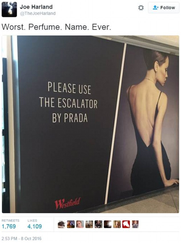 An eagle-eyed shopper snapped a photo of a sign at a London shopping centre bearing the helpful instructions 'Please use the escalator by Prada' - which seemed to allude to a clumsily titled new scent
