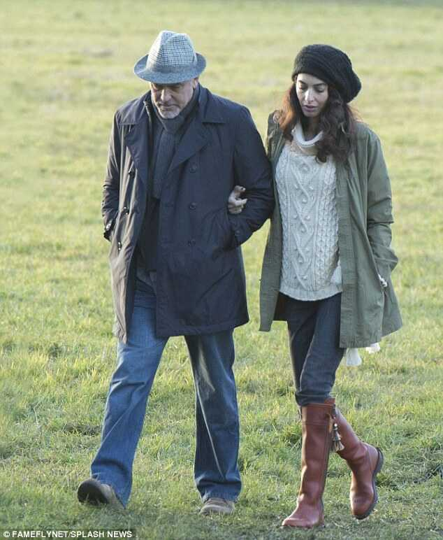 +5 Covered up: On January 12, Amal covered up as she walked with her actor spouse near their house in Sonning, UK