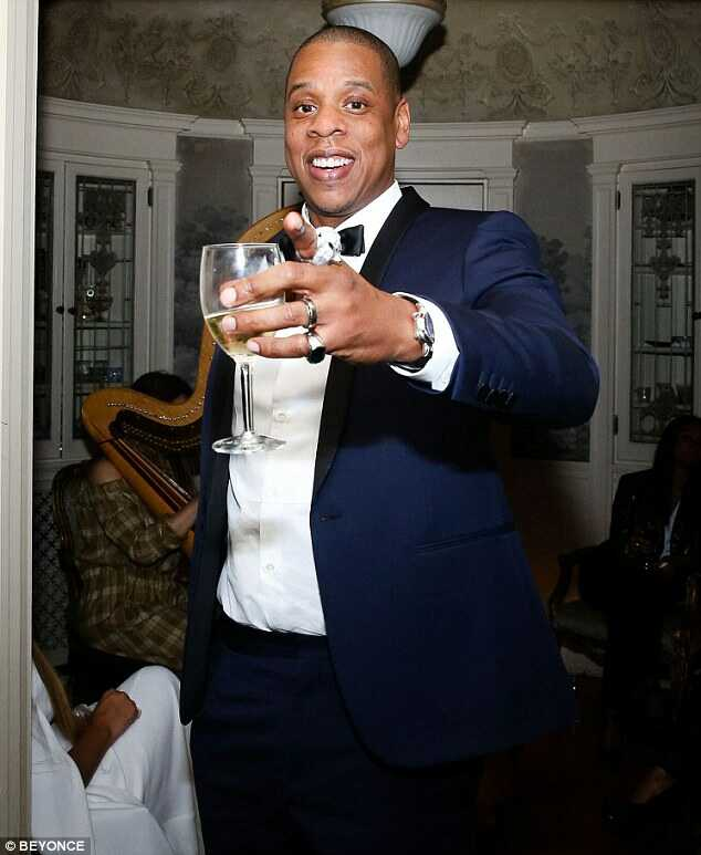Cheers: Jay Z is set to become the first rapper ever inducted into the Songwriters Hall of Fame, it was revealed on Wednesday. Here he is pictured at a post Grammy party in LA this month